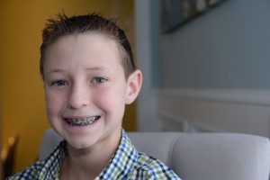 Young boy with braces Defay Orthodontics